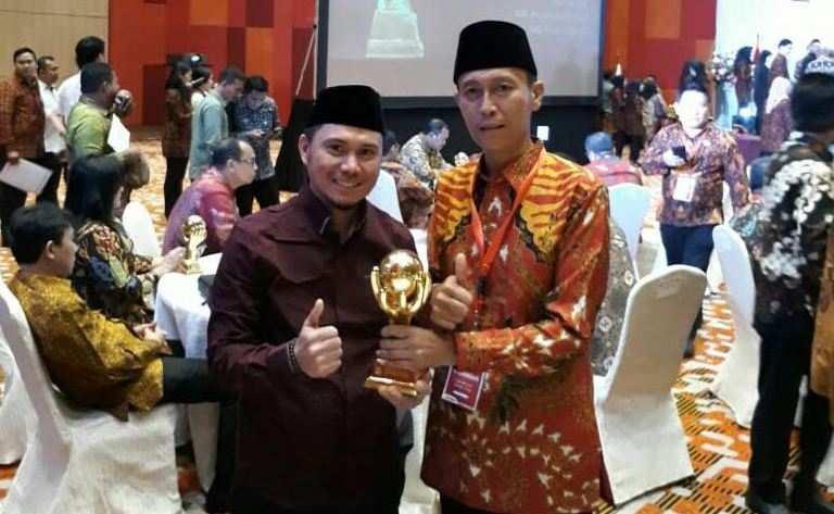 Bolsel Terima UHC Award dari Mendagri Advertorial