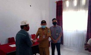 Camat Noldy Tangahu Serahkan BST untuk 473 KPM di 11 Desa Kecamatan Helumo Berita Bolsel Berita Daerah Berita Nasional Sulut