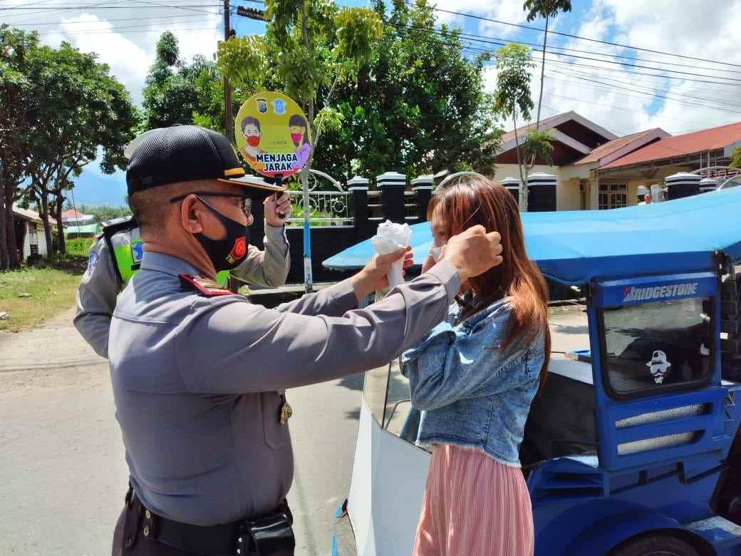 Polres Kotamobagu Gelar Sosialisasi dan Pembagian Masker Gratis Untuk Masyarakat Berita Hukum Berita Kotamobagu